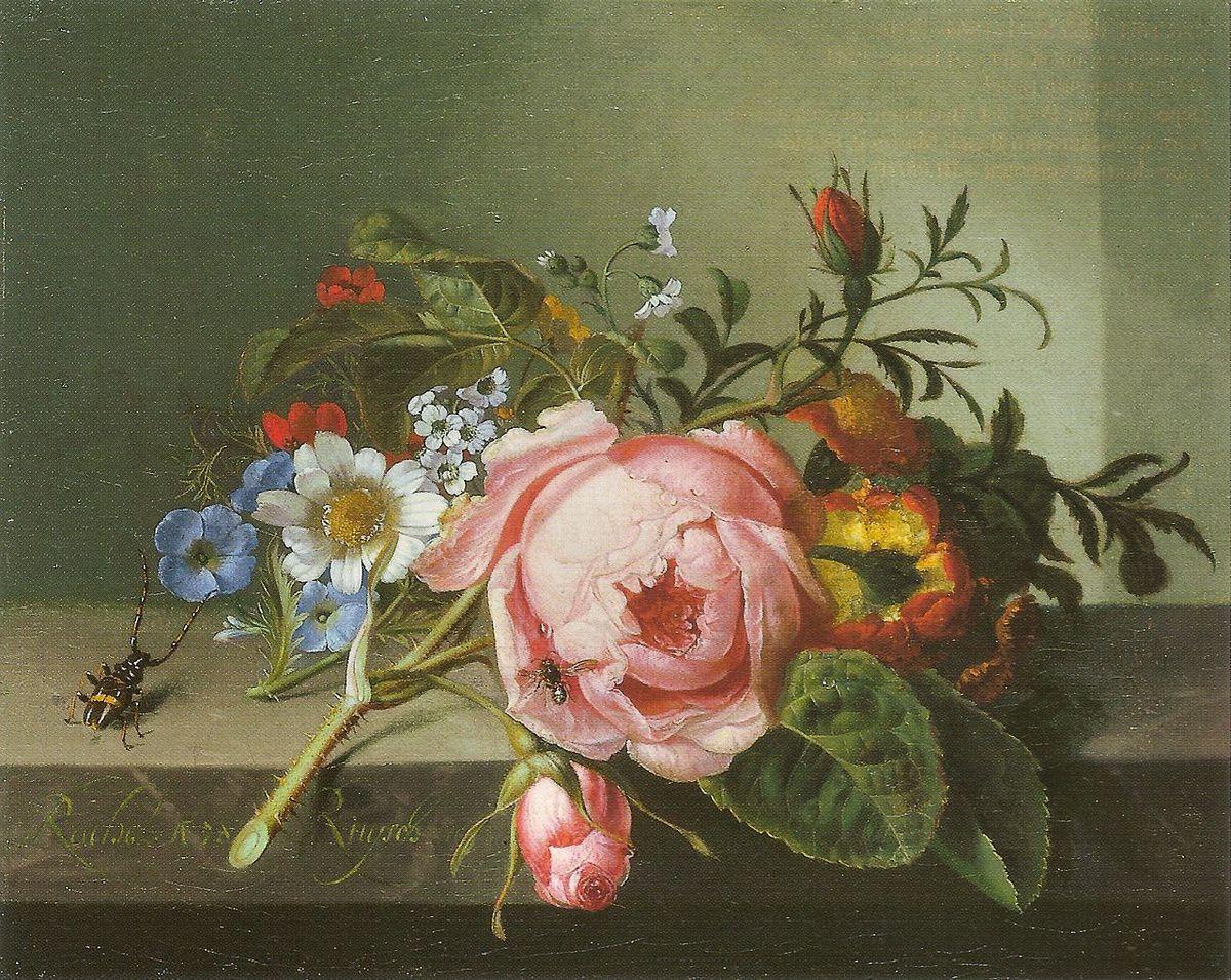 Rožė puokštėje su kitomis gėlėmis.